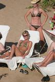 http://img16.imagevenue.com/loc511/th_38309_ParisHilton_Beach01_123_511lo.jpg