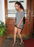 Christina Milian leaving Madeo's in Beverly Hills. Wearing short tight dress showing legs. Having an accidetn as she step in car. Upskirt shows her lace sheer black panties.